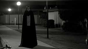 A Girl Walks Home Alone At Night Image